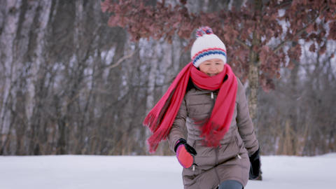 Asain Woman Freezing On Cold Day Image