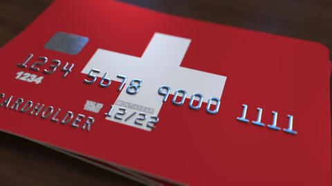 Plastic bank card featuring flag of Switzerland. National banking system related Live Action