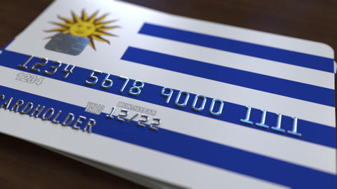 Plastic bank card featuring flag of Uruguay. National banking system related Footage
