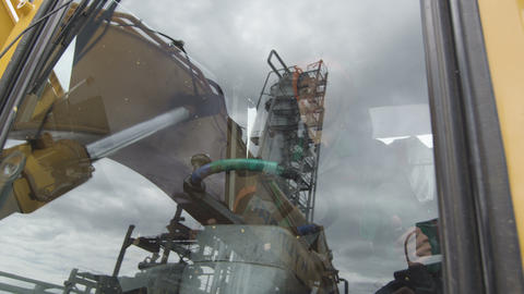 Employee Drives Hoisting Gear against Smoke Towers Footage
