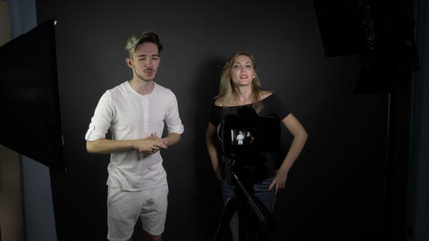 Young attractive teenagers couple in a professional studio shooting videos for Footage