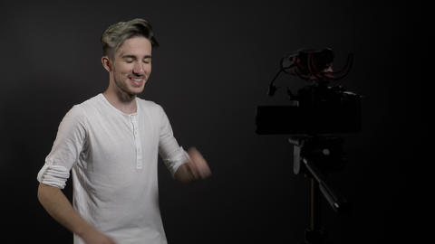 Young man recording in studio a tutorial about how to promote and like videos in Footage