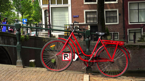 Great shot of a red bicylcle in Amsterdam typical Amsterdam picture City of Amst Footage