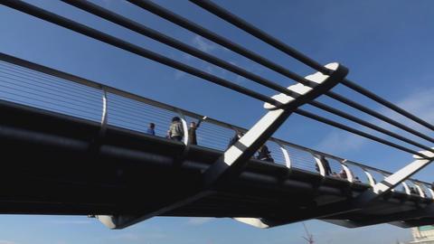 Pedestrians on Millennium Bridge - LONDON, ENGLAND Live Action
