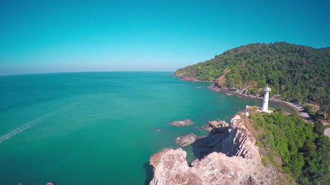 Flying over lighthouse on coast of Lanta island 4k Footage