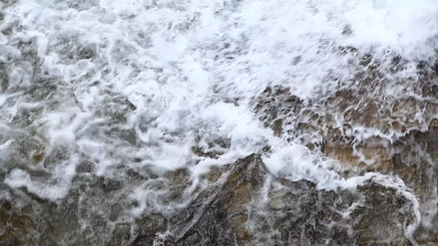 water running Through mossy rocks Footage