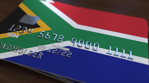 Plastic bank card featuring flag of South Africa. National banking system Live Action