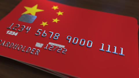 Plastic bank card featuring flag of China. National banking system related Footage