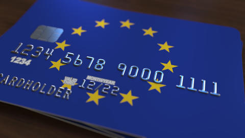 Plastic bank card featuring flag of the European Union. National banking system Footage