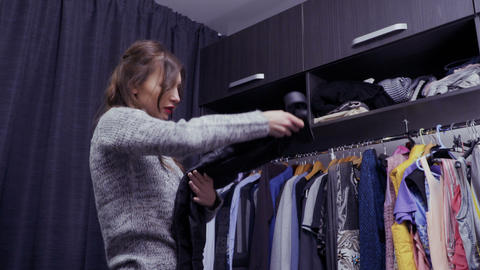 Young beautiful woman chooses clothes for special event in her dressing room Live Action