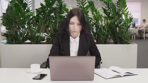 Business woman see good news on the laptop, laughs and rejoicing in success Footage