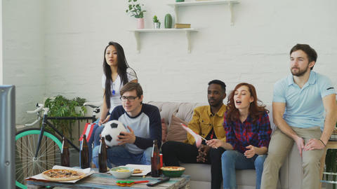 Multi-ethnic group of friends sports fans with Austrian flags watching football Footage