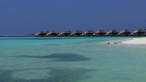 Overwater Villas In Maldives Luxury Resort With Turquoise Sea Water Image