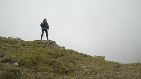 Concept of freedom and happiness with mountaineer joyful woman reaching the Footage
