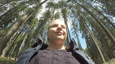 Pov of young tourist woman enjoying the nature on a sunny day in a pine forest Footage