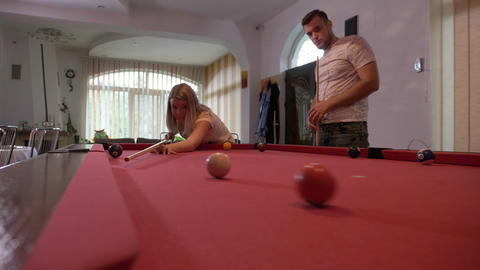 Couple of students spending time together playing pool Footage