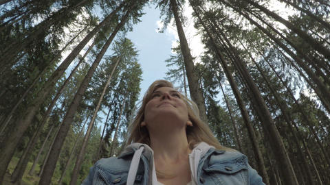 POV of eco friendly girl smiling and admiring the beauty of nature with 360 view Footage