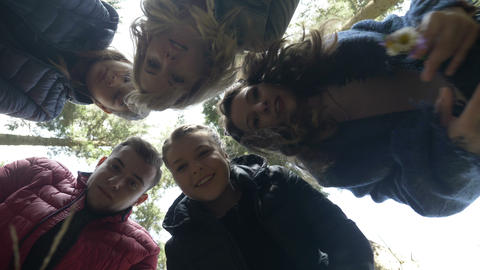 Up view of young curious explorers hiking in the woods discovering something Live Action