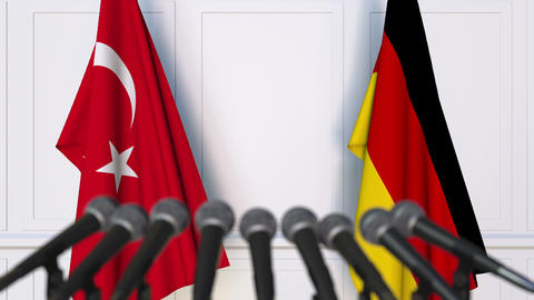 Flags of Turkey and Germany at international meeting or negotiations press Footage