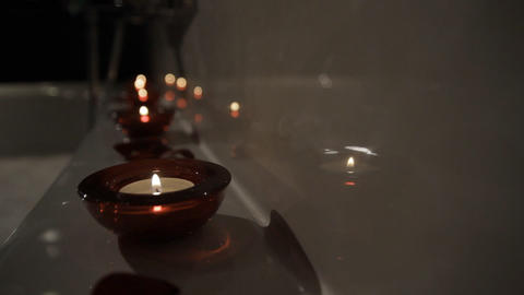 Aromatic Candle in Bath Live Action