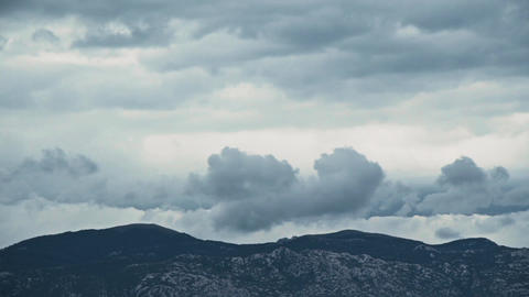 Distant Mountain Range Grey Boiling Clouds Timelapse Footage