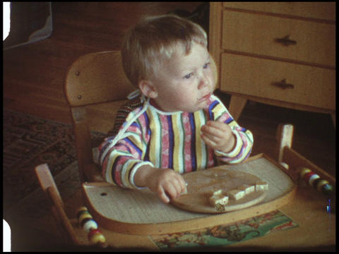 Baby eating bread 1 Live Action