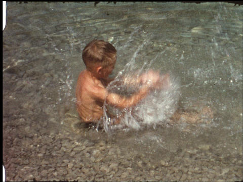 Boy splashing in water Live Action