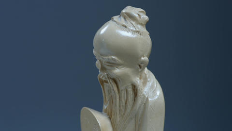 Statuette of an oriental elder Live Action