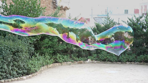 Large soap bubble waving in the air and bursted out Footage