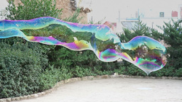 Large soap bubble waving in the air and bursted out Stock Video Footage