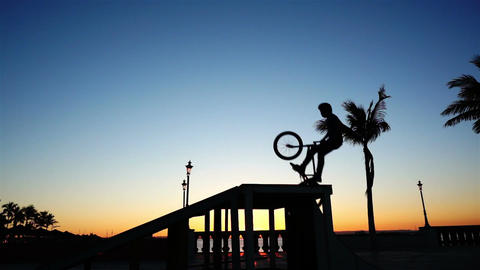 BMX Biker Silhouette Doing a No Hands Jump Footage