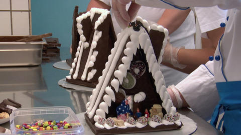 three german confectioner build gingerbread house 10780 Stock Video Footage