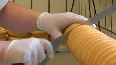 german confectioner cuts baumkuchen cake 10794 Stock Video Footage