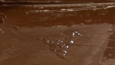 german confectioner dip baumkuchen cake in chocolate... Stock Video Footage