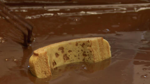 german confectioner dip baumkuchen cake in chocolate close 10798 Footage
