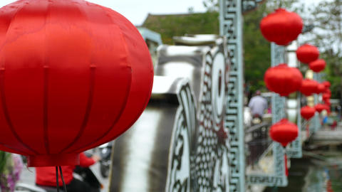 Red lanterns at the Cau An Hoi bridge in Hoi An Footage