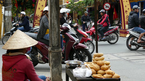 Vietnamese lady selling bread at a crossroad Footage