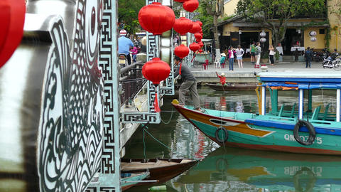 Boat enter the Cau An Hoi bridge with red lanterns in Hoi An Footage