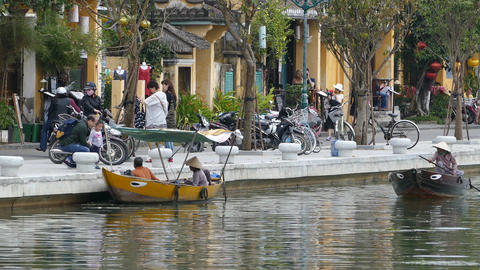 Boats at the thu bon river and tourists in the Old town of Hoi An Footage