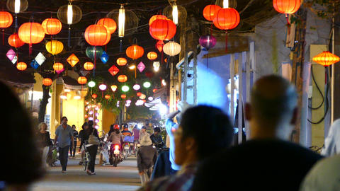 Time lapse from a street with Colorful lanterns and people in the old town of Ho Footage