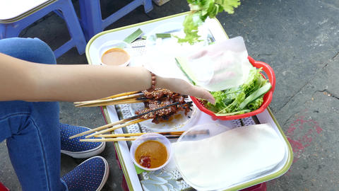 Preparing the Pork skewer/ grilled pork wrapped in rice paper and vegetables Live Action