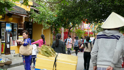Vietnamese woman selling food in old town of Hoi An Footage