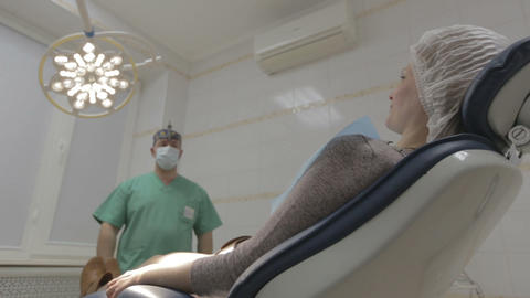 Dentist chair move down with patient Footage