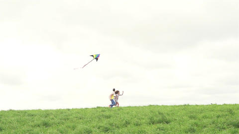 Boy And Girl With Kite On A Field Footage