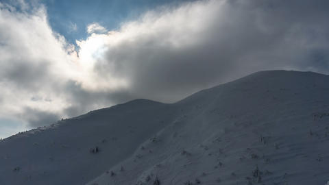 Dramatic clouds over winter snowy mountains Footage
