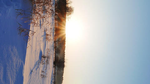 Vertical video. Winter landscape at sunset. Russia Footage