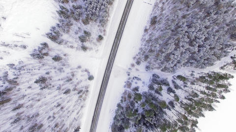 Aerial top-down view of countryside highway in winter in Finland Footage