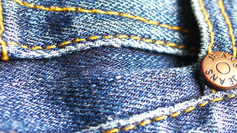 Metal button on jeans close up Live Action