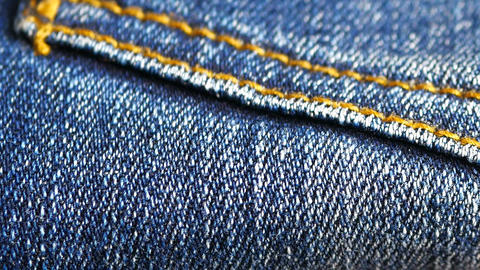 Blue denim jeans close up stock footage close up with a sliding camera move Live Action