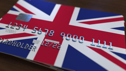 Plastic bank card featuring flag of Great Britain. National banking system Live Action